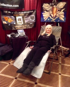 Celeste demonstrating the BEMER at Conscious Life Expo!